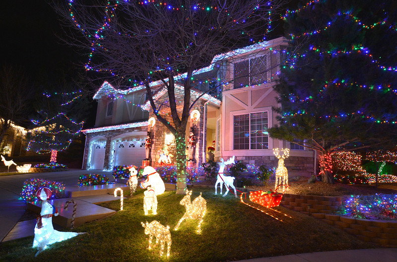 Holiday lighting display at 4341 Crestone Circle in Broomfield gives a lighting and multi media show synced with the music broadcast to car radios. <br /> December 6, 2012<br /> staff photo/ David R. Jennings