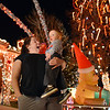 Rachel Walker and her son Joshua, 1, look at the holiday lighting display at 1188 Clubhouse Drive in Broomfield.<br /> December 6, 2012<br /> staff photo/ David R. Jennings
