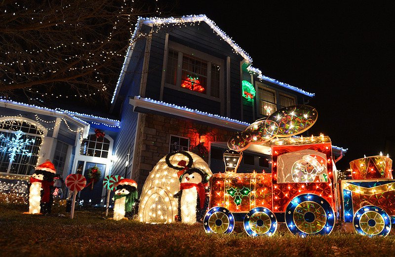 A train along with penguins and an igloo are part of the holiday lighting display at 1005 11th Ct. in Broomfield.<br /> December 6, 2012<br /> staff photo/ David R. Jennings