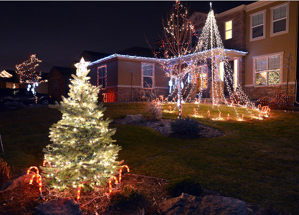 Holiday lighting display at 16719 Cathedral Way in Broomfield  gives a lighting show synced with the music broadcast to car radios.  <br /> December 6, 2012<br /> staff photo/ David R. Jennings