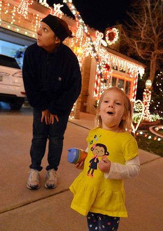 Alice Walker, 3, with Kim Weibert, left, looks at Weibert's holiday lighting display at 1188 Clubhouse Drive in Broomfield.<br /> December 6, 2012<br /> staff photo/ David R. Jennings