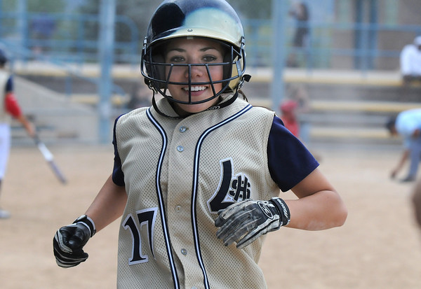Shae Rodgriguez, Legacy, smiles after making a run during the Erie Tournament at Stazio Ballfields in Boulder on Friday.<br /> <br /> Sept. 4, 2009<br /> Staff photo/David R. Jennings