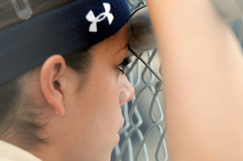 Buggs Torrez, catcher Legacy, watches the game against Shiatook, OK, from the dugout during the Erie Tournament at Stazio Ballfields in Boulder on Friday.<br /> <br /> Sept. 4, 2009<br /> Staff photo/David R. Jennings
