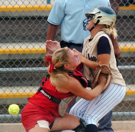 Kaitlyn Mattila, Legacy, right, collides with Higgins, Shiatook, OK, at home plate during the Erie Tournament at Stazio Ballfields in Boulder on Friday.<br /> <br /> Sept. 4, 2009<br /> Staff photo/David R. Jennings