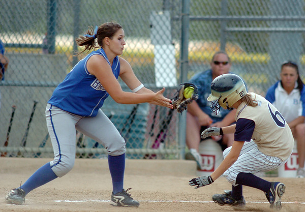 Broomfield's 3rd baseman tags out Keira Bell, Legacy during the Erie Tournament at Stazio Ballfields in Boulder on Friday.<br /> <br /> Sept. 4, 2009<br /> Staff photo/David R. Jennings