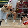 Kaitlyn Mattila, Legacy, catches the ball at thirdbase as Tucker, Shaitook, OK, slides during the Erie Tournament at Stazio Ballfields in Boulder on Friday.<br /> <br /> Sept. 4, 2009<br /> Staff photo/David R. Jennings