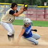 Jessica Ball, Legacy, left, catches the ball as #17 Broomfield, slides to second base during the Erie Tournament at Stazio Ballfields in Boulder on Friday.<br /> <br /> Sept. 4, 2009<br /> Staff photo/David R. Jennings