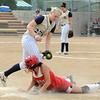 Molly Madsen, Legacy, tries to tag out Coody, Shiatook, OK, at first base during the Erie Tournament at Stazio Ballfields in Boulder on Friday.<br /> <br /> Sept. 4, 2009<br /> Staff photo/David R. Jennings
