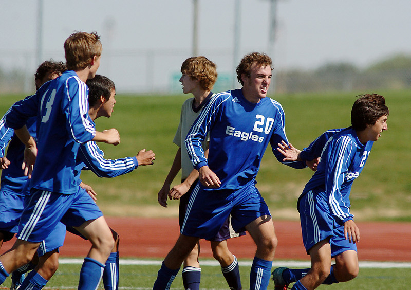 The Broomfield team celebrates after they scored the winning goal against Legacy in overtime during the first Legacy-Broomfield boys soccer game at North Stadium on Saturday.<br /> <br /> October 2, 2010<br /> staff photo/David R. Jennings