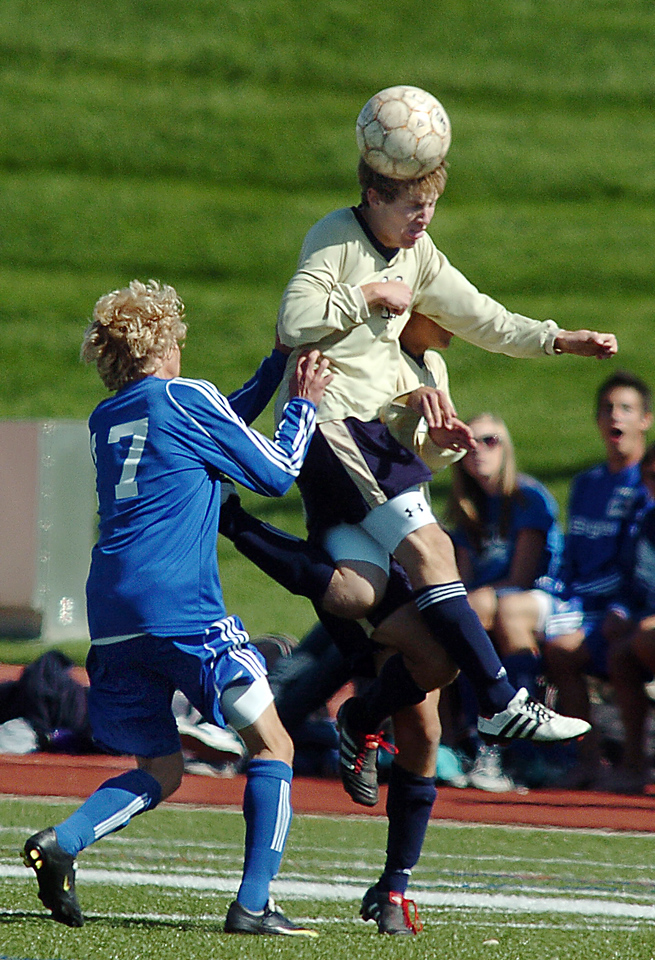 John Hyatt, Legacy, does a header over Broomfield's Tim Ayers during the first Legacy-Broomfield boys soccer game at North Stadium on Saturday.<br /> <br /> October 2, 2010<br /> staff photo/David R. Jennings