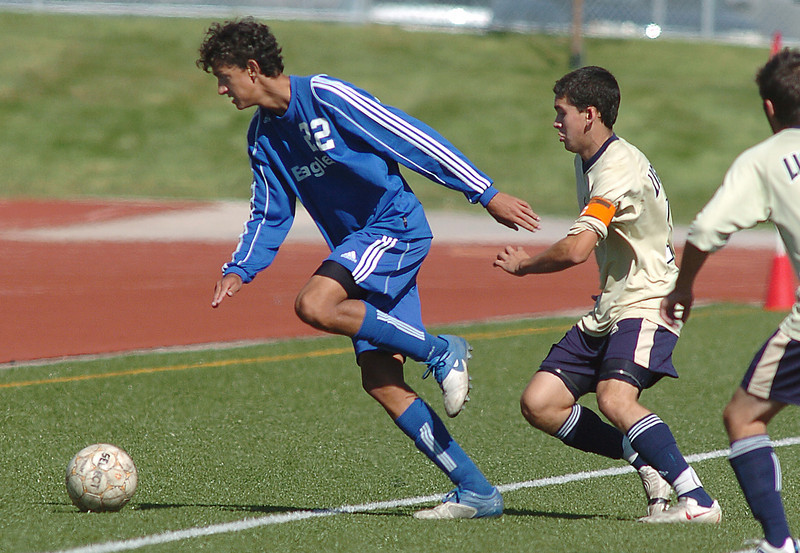 Broomfield's Colton Lamb stays ahead of  Legacy's Hugo Aguirre during the first Legacy-Broomfield boys soccer game at North Stadium on Saturday.<br /> <br /> October 2, 2010<br /> staff photo/David R. Jennings