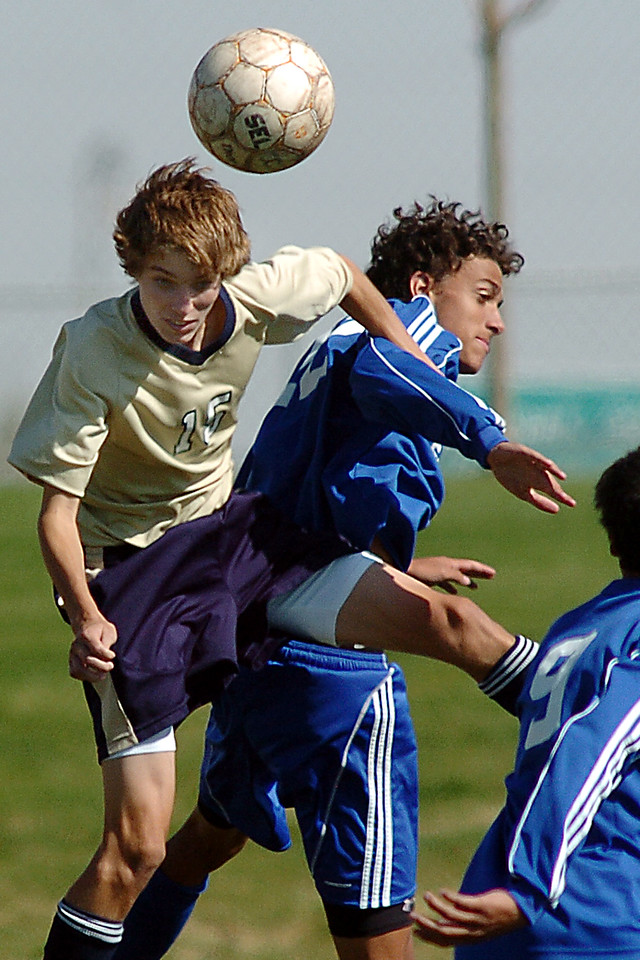 Kyle Morrow, Legacy, collides with Colton Lamb, Broomfield, for a header during the first Legacy-Broomfield boys soccer game at North Stadium on Saturday.<br /> <br /> October 2, 2010<br /> staff photo/David R. Jennings