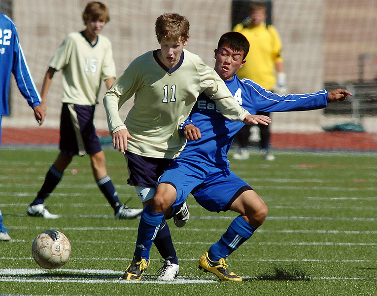 Legacy's John Hyatt and Broomfield's Alex Tagawa fight for control of the ball during the first Legacy-Broomfield boys soccer game at North Stadium on Saturday.<br /> <br /> October 2, 2010<br /> staff photo/David R. Jennings