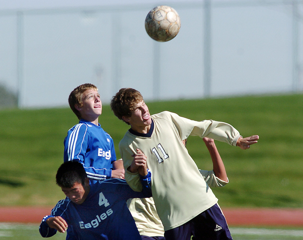 Broomfield's Alex Tagawa goes for a header with John Hyatt, Legacy, during the first Legacy-Broomfield boys soccer game at North Stadium on Saturday.<br /> <br /> October 2, 2010<br /> staff photo/David R. Jennings