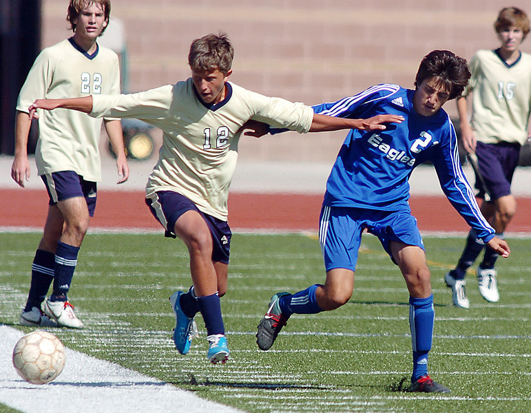Kyle Morrow, Legacy does a header against Colton Lamb, Broomfield during the first Legacy-Broomfield boys soccer game at North Stadium on Saturday.<br /> <br /> October 2, 2010<br /> staff photo/David R. Jennings