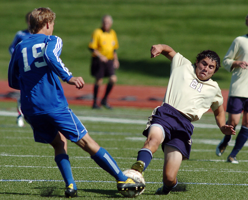Legacy's Jacob Gonzalez fights for the ball with Broomfield's Blake Seitz during the first Legacy-Broomfield boys soccer game at North Stadium on Saturday.<br /> <br /> October 2, 2010<br /> staff photo/David R. Jennings