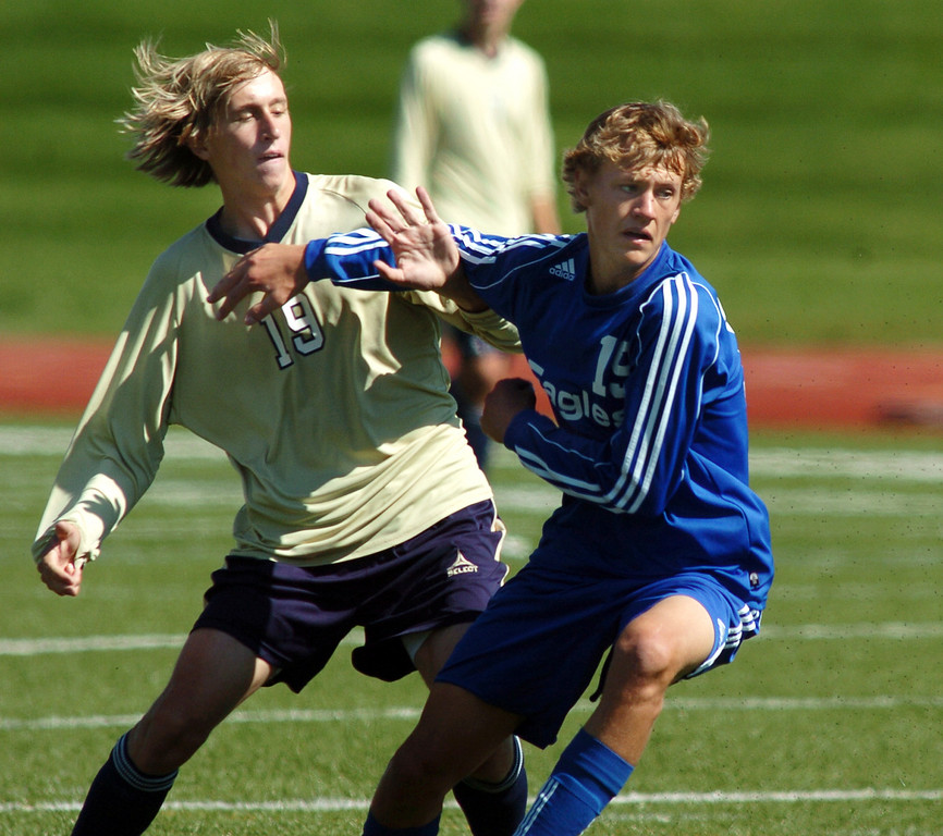 Legacy's Tanor Rainwater and Broomfield's Blake Seitz fight to get to the ball during the first Legacy-Broomfield boys soccer game at North Stadium on Saturday.<br /> <br /> October 2, 2010<br /> staff photo/David R. Jennings