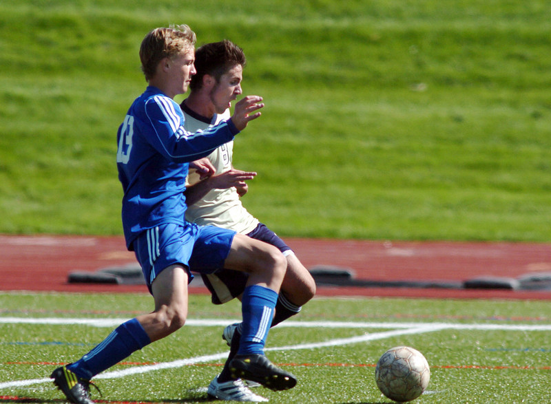 Broomfield's Mario Zamora and Legacy's Justin Walters fight for control of the ball during the first Legacy-Broomfield boys soccer game at North Stadium on Saturday.<br /> <br /> October 2, 2010<br /> staff photo/David R. Jennings