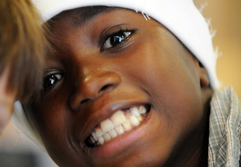 Mawolo Easton, 8, smiles for the camera during Wednesday's Jump Start Literacy Camp at Presbyterian Church of Broomfield.<br /> July 21, 2010<br /> Staff photo/ David R. Jennings