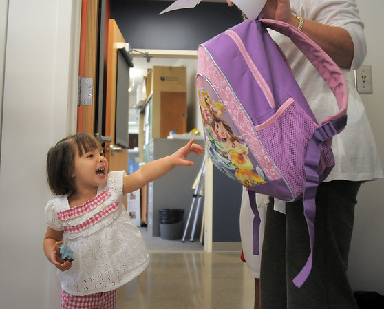 Grace Zechmann, 2 1/2, looks at her backpack after the Little Eagles Playschool child development class at Broomfield High School on Wednesday. <br /> October 16, 2011<br /> staff photo/ David R. Jennings