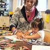 Broomfield High junior Stephanie Pratt colors with Grace Zechmann, 2 1/2, during the Little Eagles Playschool child development class at School on Wednesday. <br /> October 16, 2011<br /> staff photo/ David R. Jennings