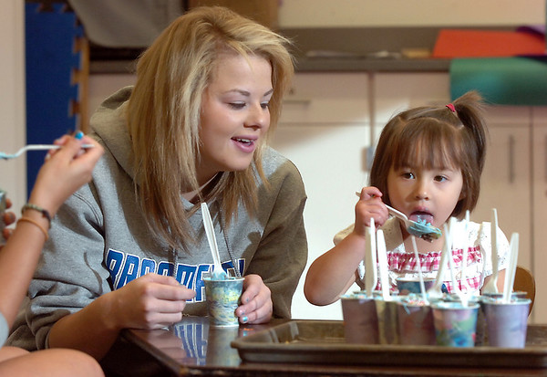 Maddie Elliott, left, talks with Grace Zechmann, 2 1/2, whle eating a snack during the Little Eagles Playschool child development class at Broomfield High School on Wednesday. <br /> October 16, 2011<br /> staff photo/ David R. Jennings