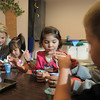 Grace Zechmann, 2 1/2, left, with Maddie Elliott, eat a snack with  Brooke Thurman, 3 1/2, and Brendan McNeal, 2 1/2, during the Little Eagles Playschool child development class at Broomfield High School on Wednesday. <br /> October 16, 2011<br /> staff photo/ David R. Jennings