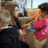 Sophomore Lexis Aragon, left, plays with Brooke Thurman, 3 1/2, whie Brendan McNeal, 2 1/2, walks by during the Little Eagles Playschool child development class at Broomfield High School on Wednesday. <br /> October 16, 2011<br /> staff photo/ David R. Jennings