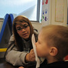 Sophomore Lexis Aragon cleans Brendan McNeal's face after eating a blue snack during the Little Eagles Playschool child development class at Broomfield High School on Wednesday. <br /> October 16, 2011<br /> staff photo/ David R. Jennings
