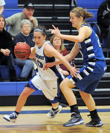 Erica Meier, Longmont, drives the ball to the basket against Meagan Prins, Broomfield during Tuesday's game at Longmont High.<br /> <br /> February 8, 2011<br /> staff photo/David R. Jennings