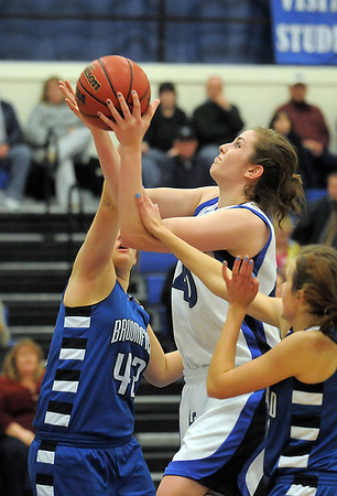 Megan Carpenter, Longmont goes for two against STacie Hull, Broomfield during Tuesday's game at Longmont High.<br /> <br /> February 8, 2011<br /> staff photo/David R. Jennings
