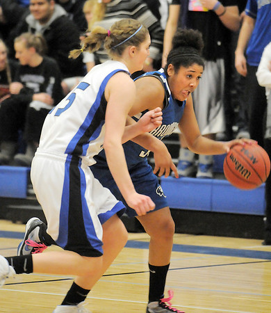 Tyana Medema, Broomfield drives the ball down court against Tambre Haddock, Longmont during Tuesday's game at Longmont High.<br /> <br /> February 8, 2011<br /> staff photo/David R. Jennings