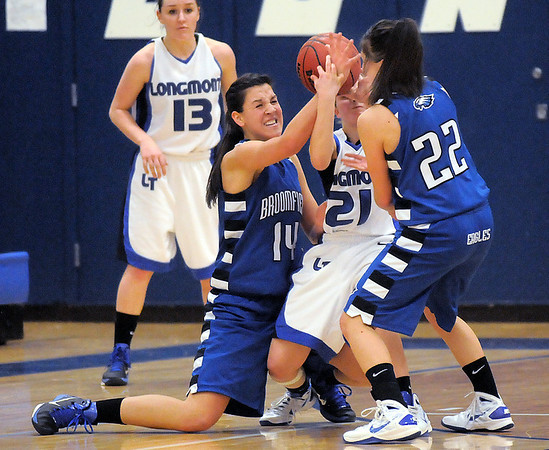 Broomfield's Katie Nehf, left, and Brittney Zec try to get the ball from Longmont's Amber Thornholt during Tuesday's game at Longmont High.<br /> <br /> February 8, 2011<br /> staff photo/David R. Jennings
