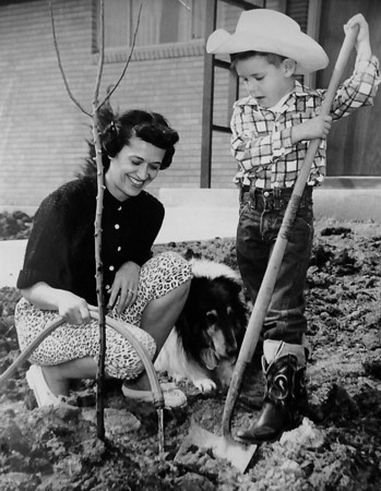 A mother and son water the lawn on April 1956.<br /> <br /> courtesy of the Depot Hill Museum.
