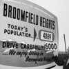 Population sign for Broomfield 1959 where Ken C. Ensor holds the sign predicting the popuation of 6,000 by 1960.<br /> <br /> <br /> courtesy of Depot Hill Museum