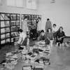 Volunteers stack books in the new Mame Doud Eisenhower Library at #12 Garden Center in 1963.