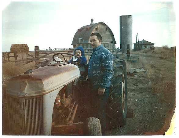 Bob Kozisek with granddaughter Wendy Bouska sitting on an old Ford Tractor in front of the Kozisek's barn, where the Brunner farmhouse is now located.<br /> <br /> courtesy of Renee Kozisek