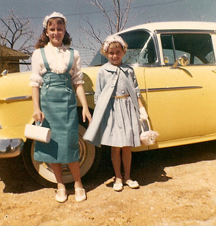 Dressed for Easter, Renee and Susie Kozisek pose in front of the new 1955 Chevy.<br /> <br /> courtesy of Renee Kozisek