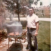 Bob Kozisek cooking steaks in the front driveway of the Kozisek farm now Midway Blvd in 1964.<br /> <br /> <br /> courtesy of Renee Kozisek