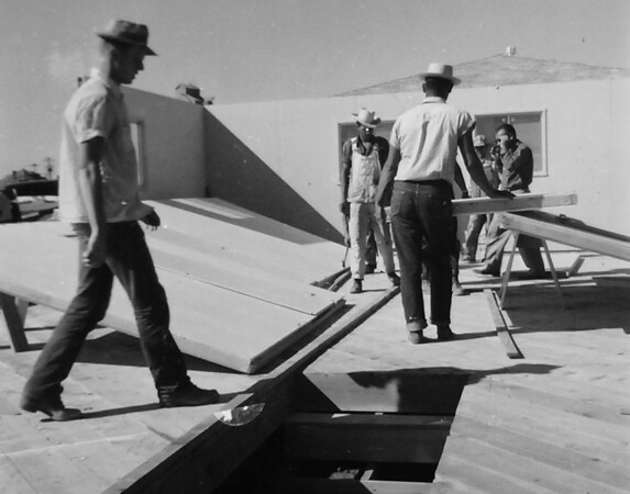Construction workers building a house in Broomfield in an undated photo. <br /> <br /> courtesy of the Depot Hill Museum