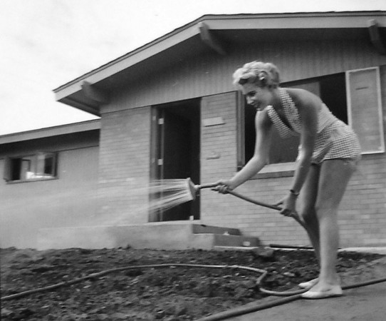A model poses watering the lawn of a house in Broomfield in an undated photo.<br /> <br /> courtesy of Depot Hill Museum