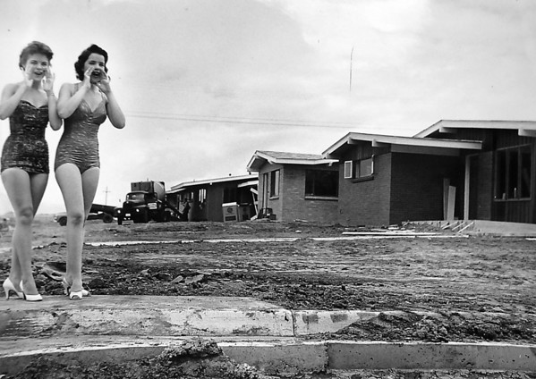 Models pose near houses under construction in the first filing of Broomfield Heights.<br /> <br /> courtesy of the Depot Hill Museum
