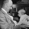 First baby born in Broomfield, Richard L. Lisk, on the lap of Ken Ensor, builder-developer. undated photograph<br /> <br /> photo courtesy of Depot Hill Museum