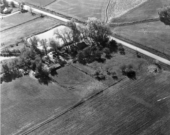 An arial view of the land where the Kozisek houses.  The dirt road is Main Street.  The lake is where the kids ride their bikes now.  The little house in the upper corner is just south of where Midway Blvd. woud be built.<br /> <br /> courtesy of Renee Kozisek