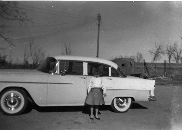 Susie Kozisek Callihan in front of the new car at the Kozisek  farm on  Midway Blvd.<br /> <br /> <br /> courtesy of Renee Kozisek