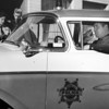 Broomfield's first Broomfield Police officer Ed McCarthy sits in the department's new police car at #8 Garden Center in 1957.<br /> <br /> <br /> <br /> photo courtesy of Depot Hill Museum