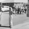 First Broomfied police officer Ed McCarthy with student crossing guard at first school cross walk at the cottage schools in 1956. <br /> <br /> courtesy of Depot Hill Museum