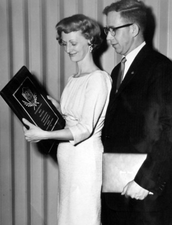 Bob and Ottilie Seeber pose with Bob's  Jaycees Outstanding Teacher <br /> Award in 1960.<br /> <br /> <br /> courtesy of the Seeber family