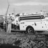Kenneth Howell and Mike Holdredge using a fire truck to water trees in Midway Park 1959.<br /> <br /> courtesy of Depot Hill Museum