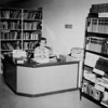 A librarian sits at her desk at the Mame Doud Eisenhower Library in the Garden Center in 1963.<br /> <br /> photo courtesy of Depot Hill Museum